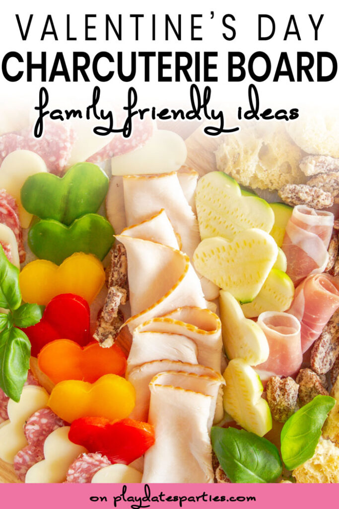 close up of a charcuterie board with heart shaped vegetables with the text Valentines Day charcuterie board family friendly ideas