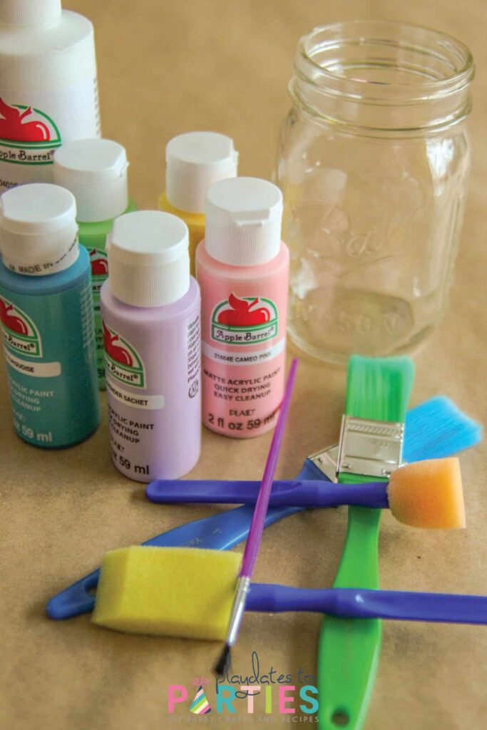 craft supplies including paint, foam brushes, and paint brushes