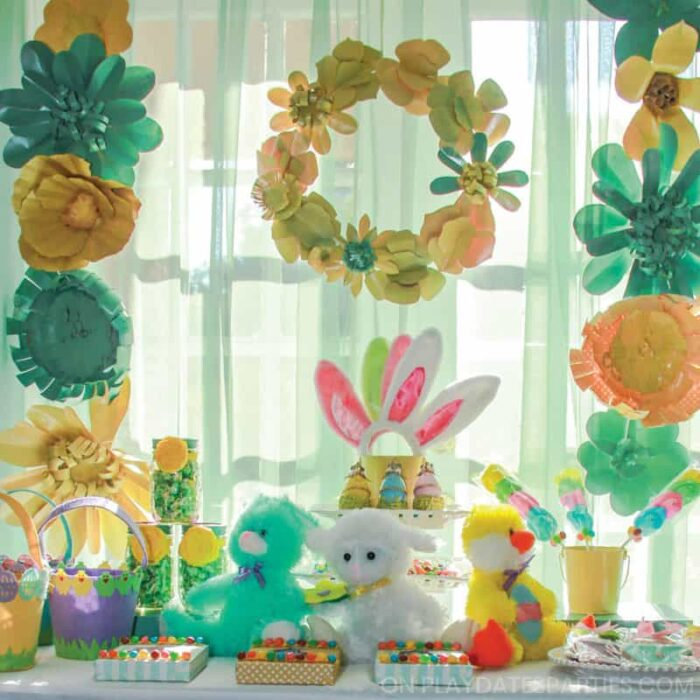 Easter treats on a table with a paper flower backdrop