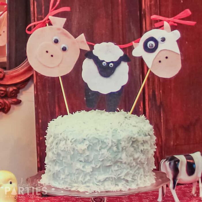 coconut cake with a felt farm animal topper