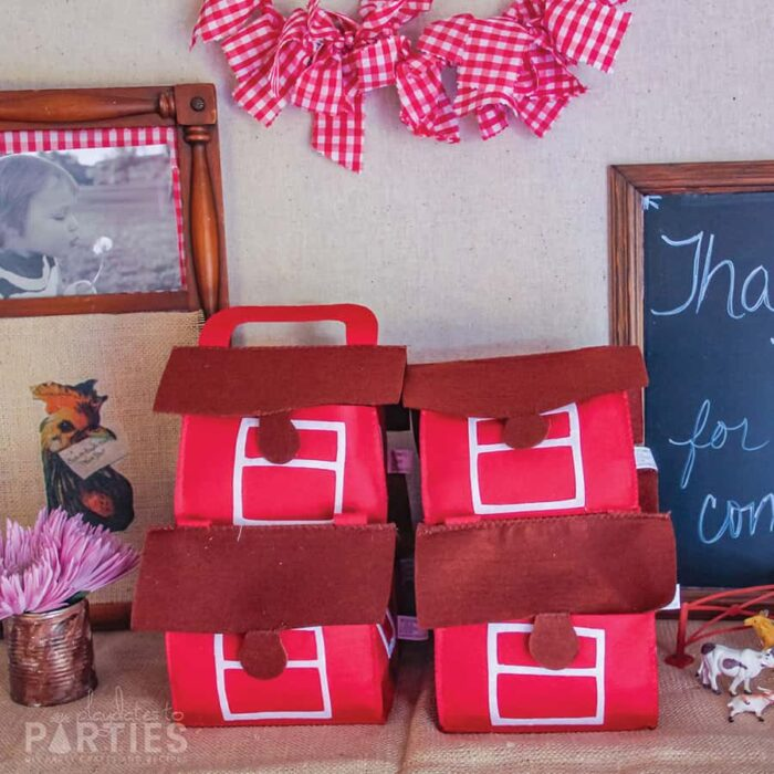 felt barn favor boxes for a farm party with a red gingham mini bunting above