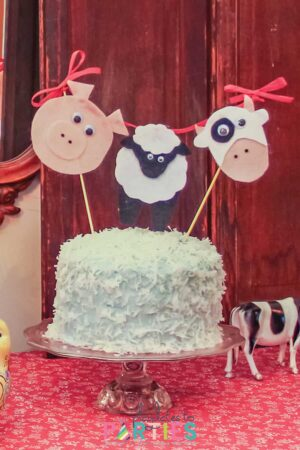 coconut cake with a farm animal topper for a barnyard birthday party