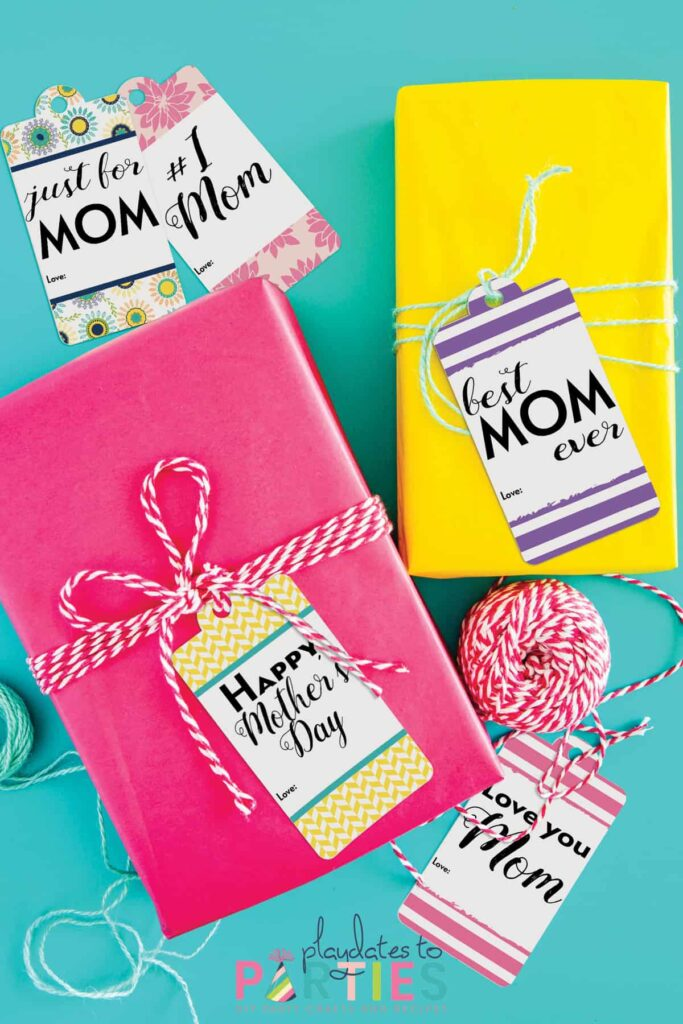 presents for mom wrapped in yellow and pink with balls of twine around them
