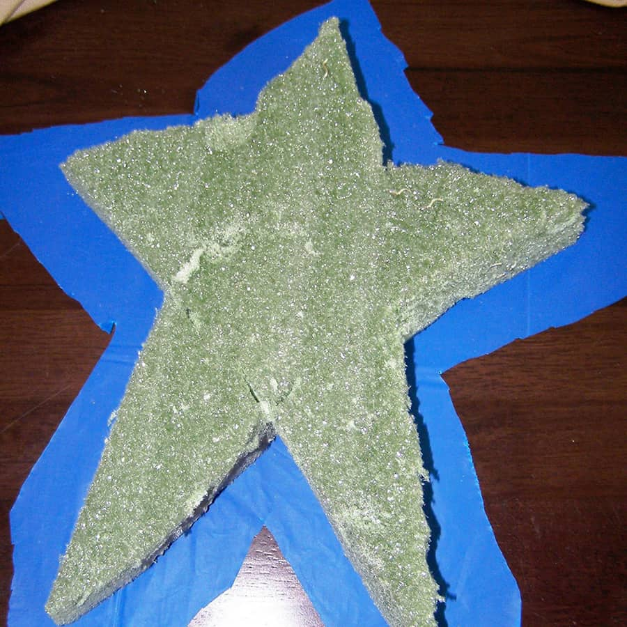 star shaped foam on top of plastic tablecloth cut to size