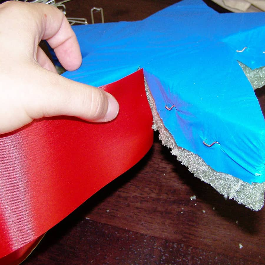placing ribbon around the side edge of the foam
