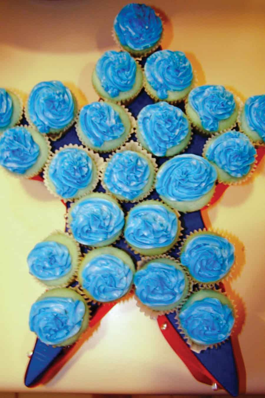 cupcakes arranged in a star shape with blue frosting