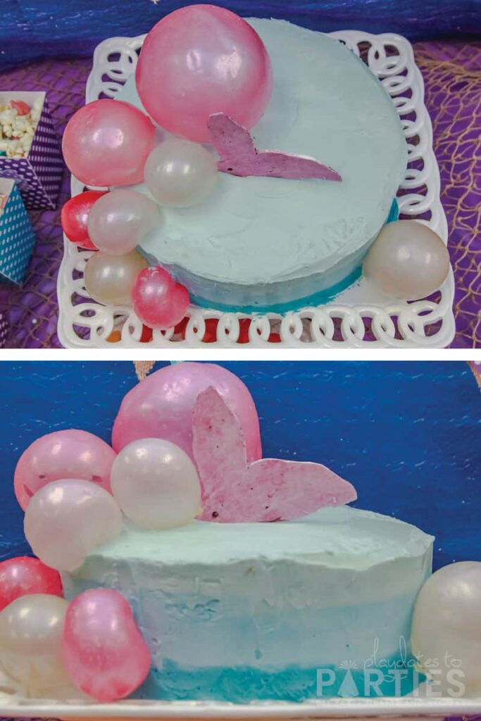 blue ombre birthday cake with pink gelatin bubbles and a purple mermaid tail coming out