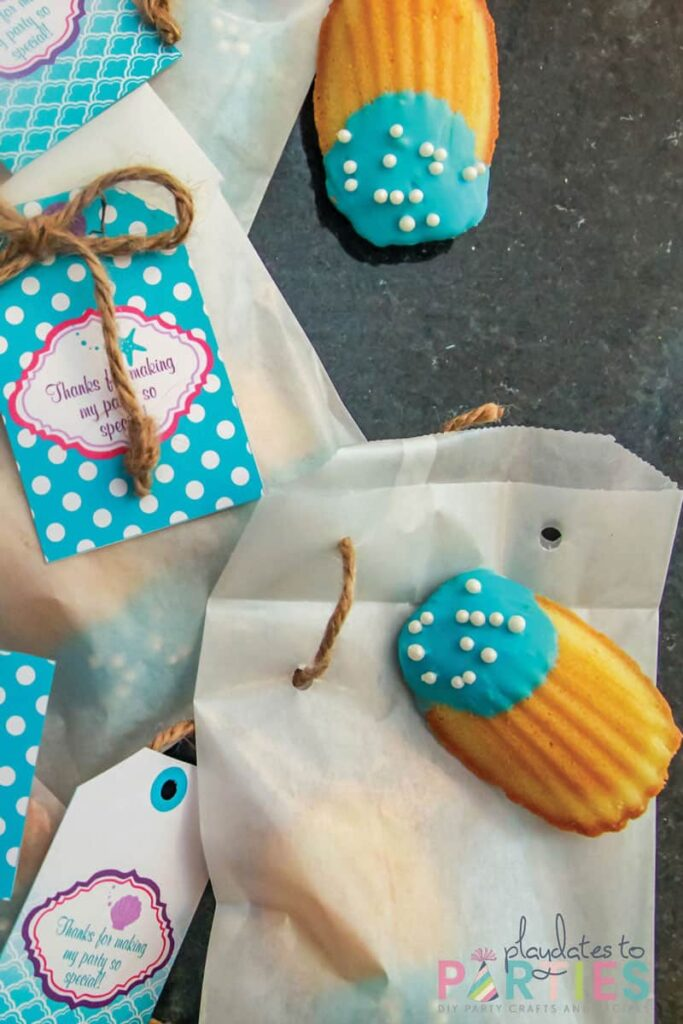 madeline cookies dipped in blue chocolate with pearl sprinkles