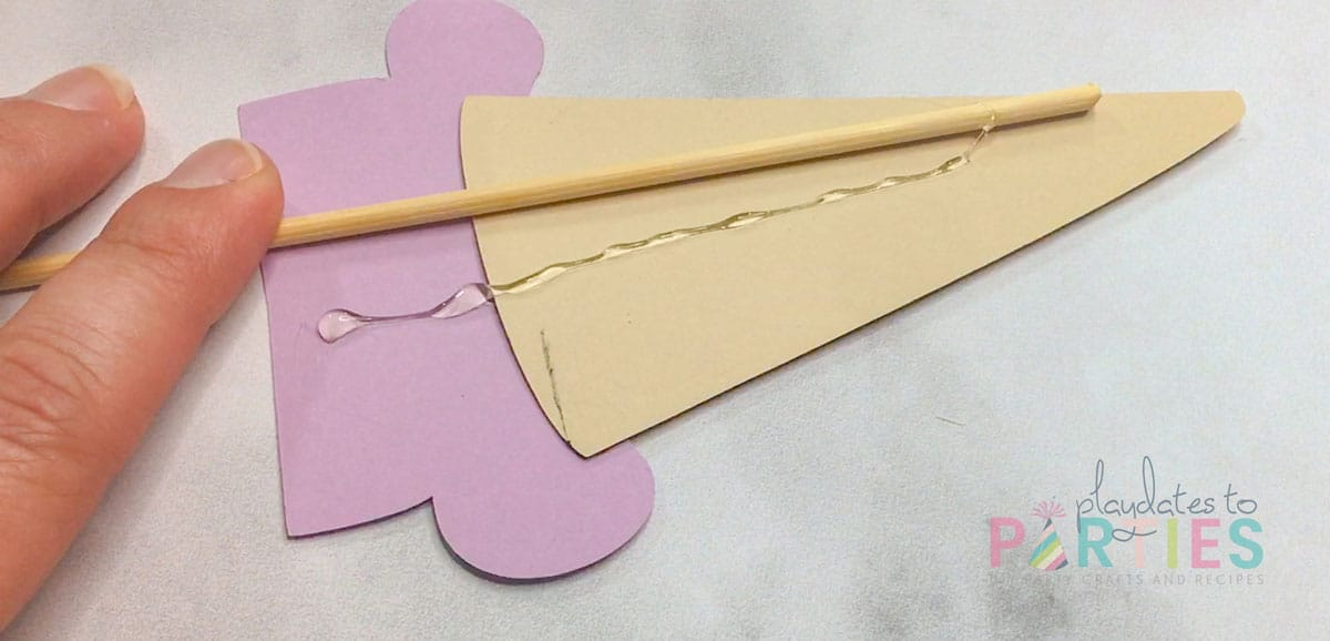 glue bamboo skewer to ice cream cutout