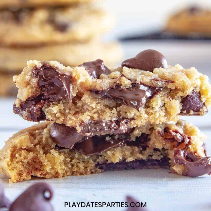 Cookie broken in half with gooey chocolate