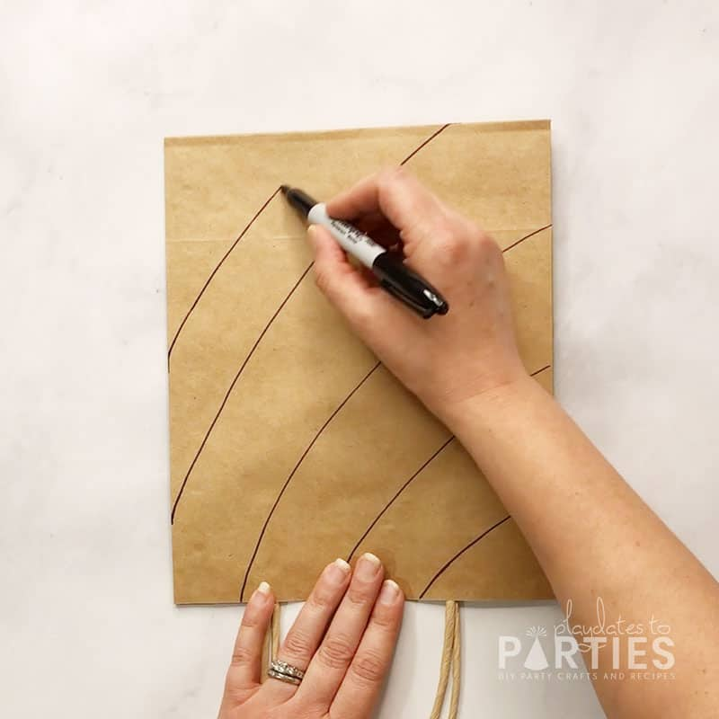 Drawing the first set of lines on the paper bag