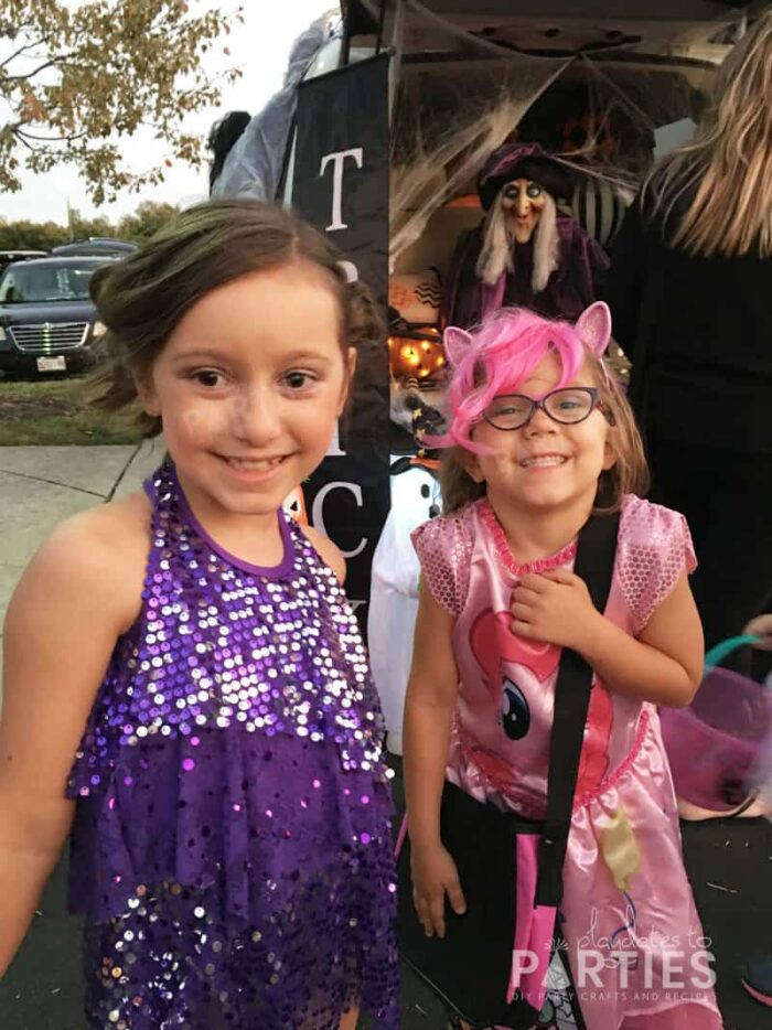 Kids trick or treating dressed as a dancer and as Pinkie Pie