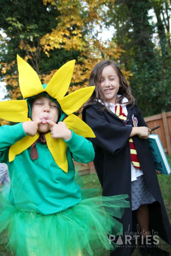 Children dressed as a sunflower and as Hermione for Halloween