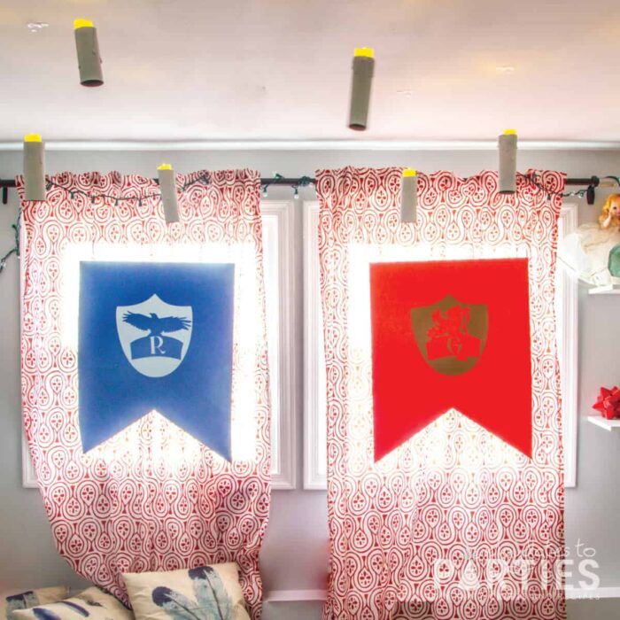 DIY Hogwarts house banners floating in front of windows with floating candles above