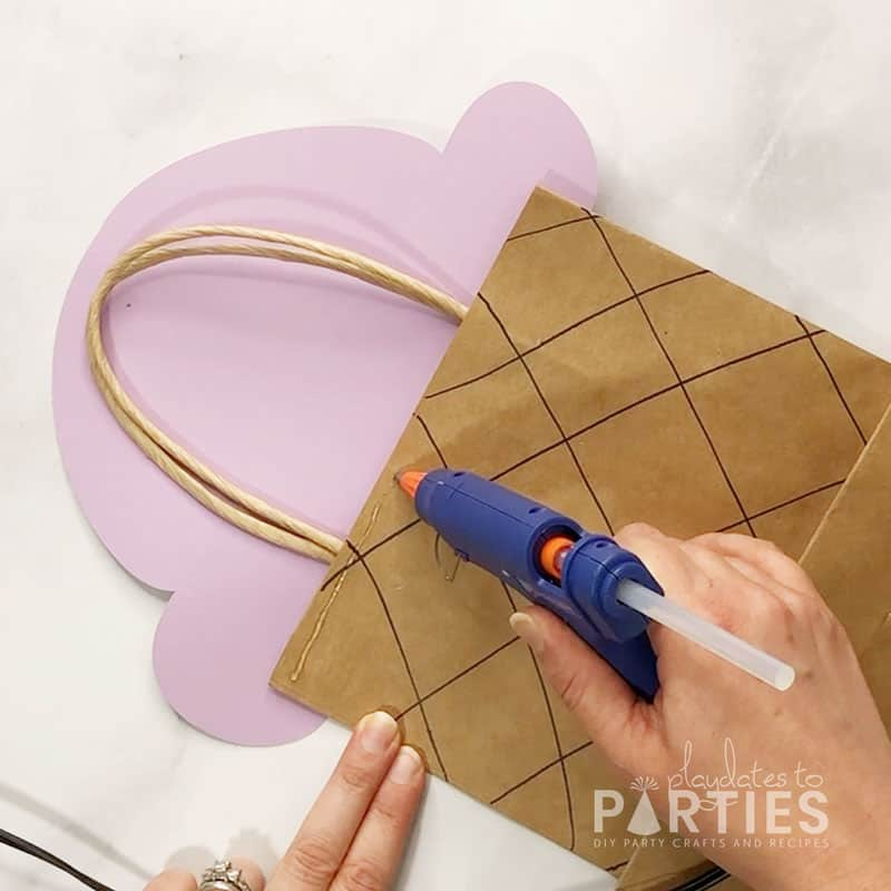 adding hot glue to the top of the bag