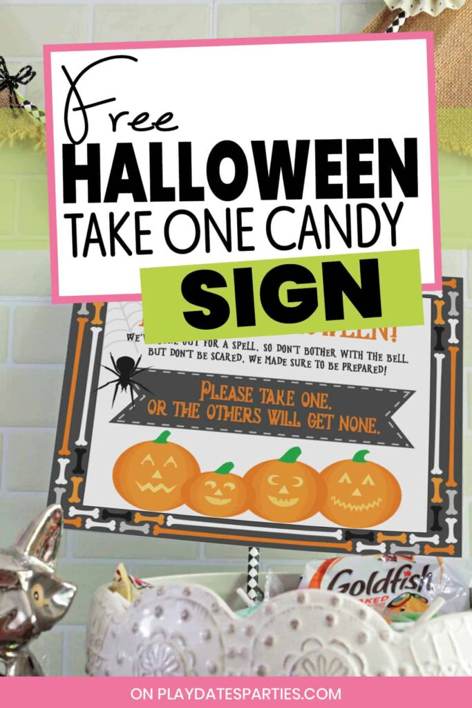 photo of a bowl of candy with a sign sticking out and the text free Halloween take one candy sign