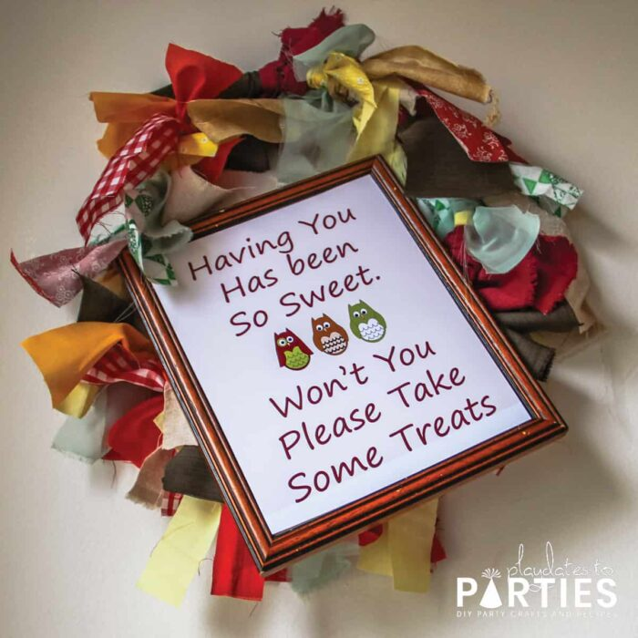 Rag wreath with a sign saying having you has been so sweet. Won't you please take some treats