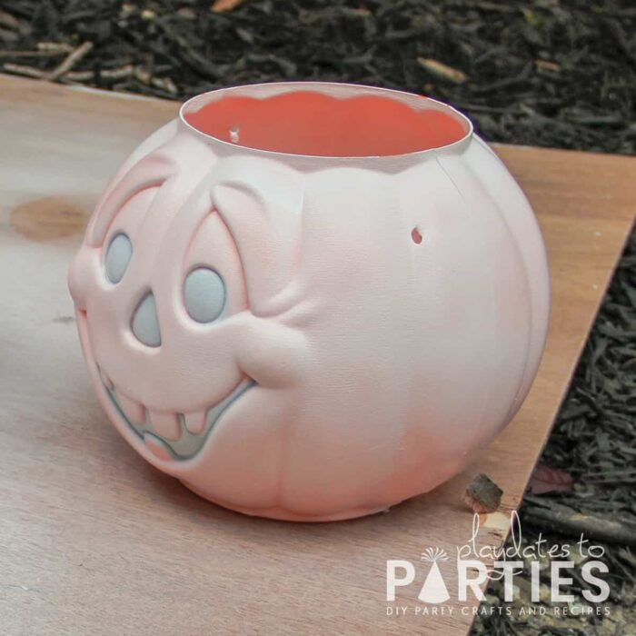 plastic jack-o-lantern bucket painted with primer