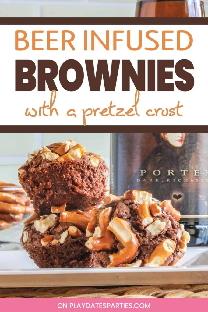 Three brownie bites topped with pretzel pieces sitting on a white plate in front of a bottle of beer with the text beer infused brownies with a pretzel crust