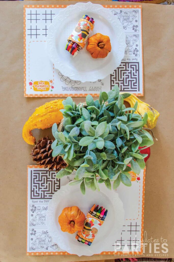 top view off a kids Thanksgiving table with a printable activity placemat