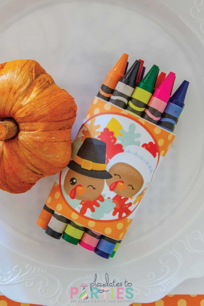 close up off a bundle of crayons wrapped with a Thanksgiving band.