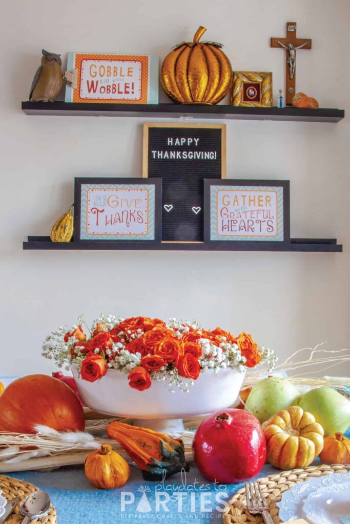 Thanksgiving signs and decorations on wall ledges
