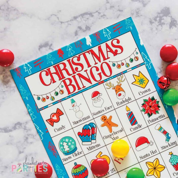 close up of a Christmas bingo card with colorful illustrations and captions in each square