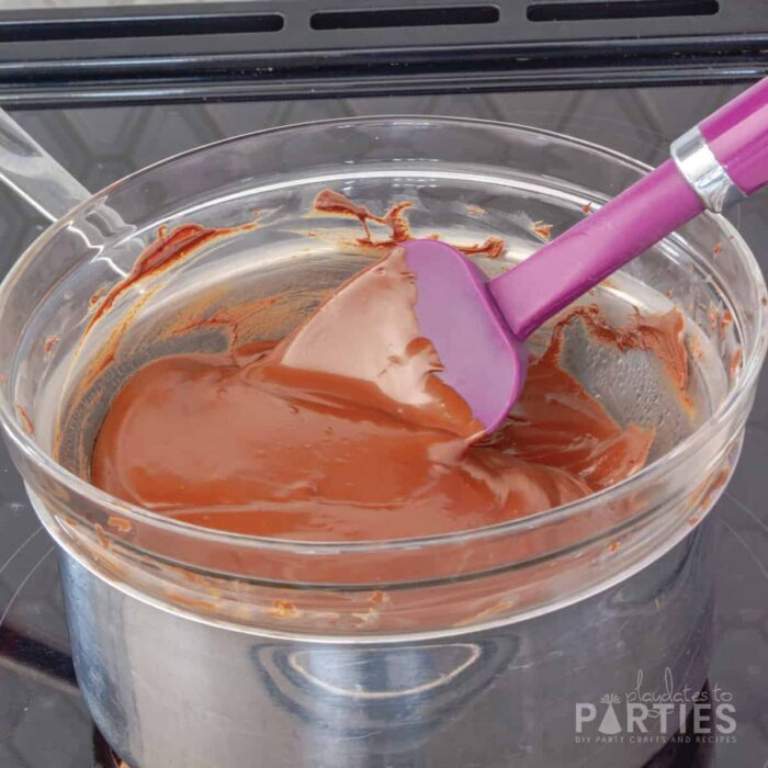 Melted chocolate in a double boiler on a stovetop