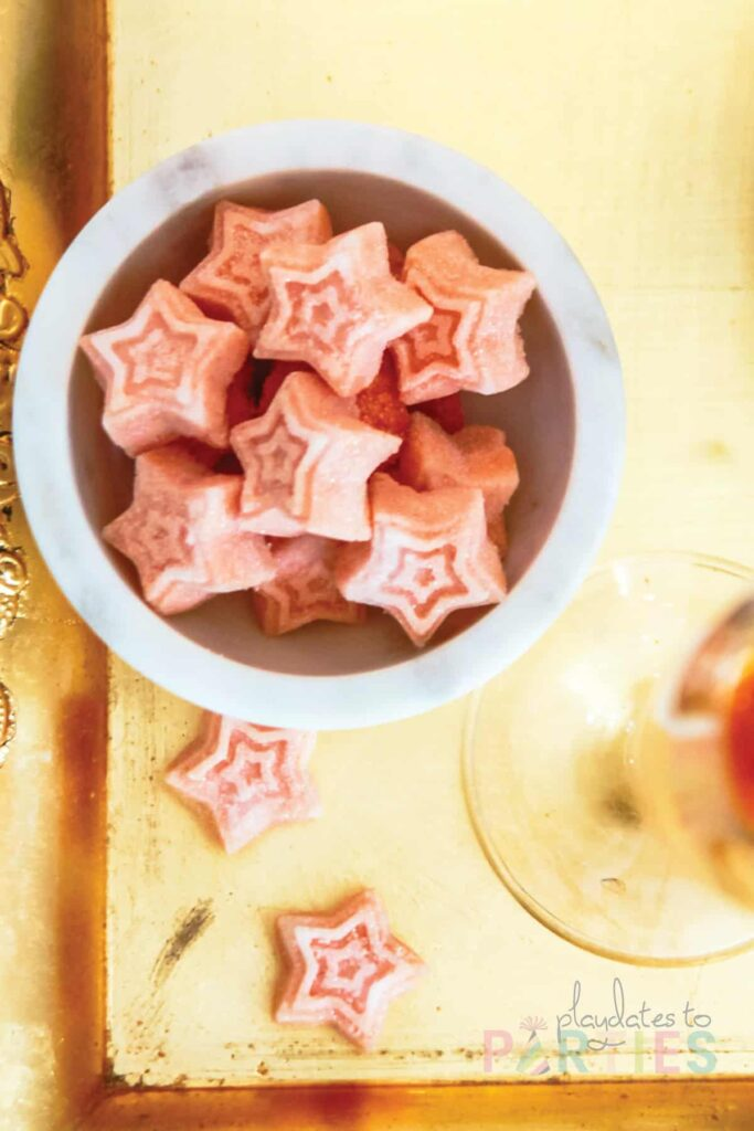 Close up of star shaped pink sugar cubes made with Angostura bitters