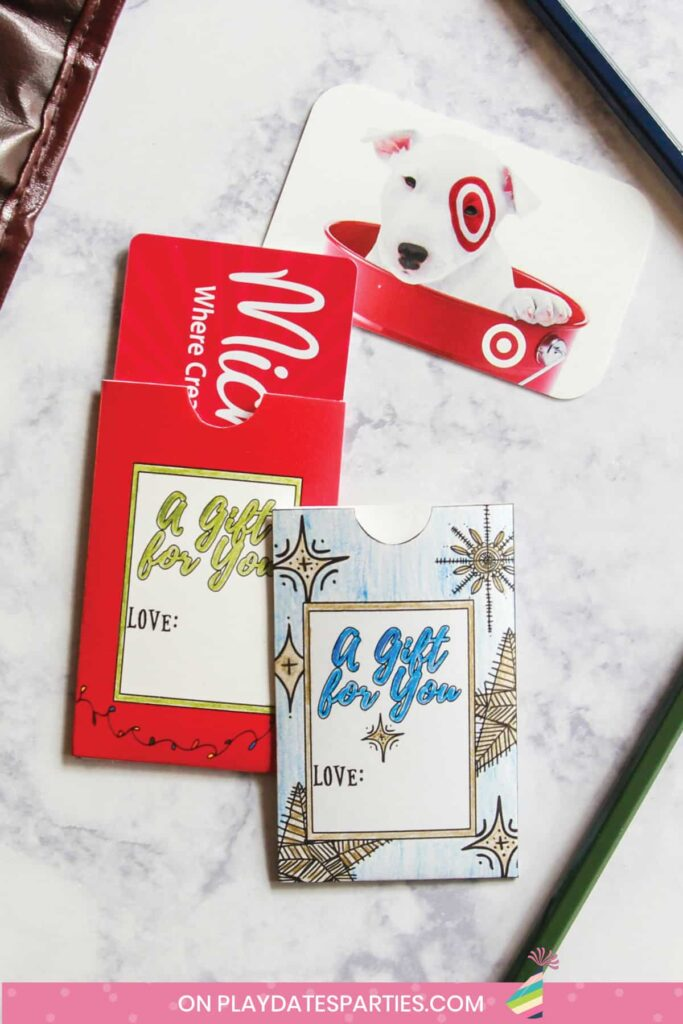 two gift card holders on a marble table with gift cards to Michaels and Target