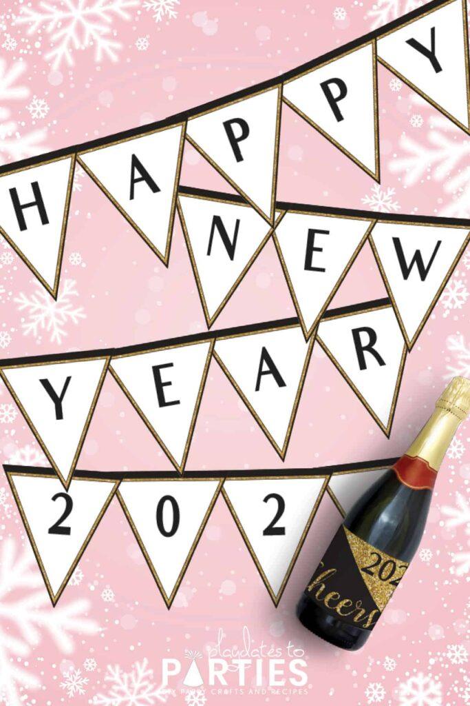 happy new year banner with black letters and a champagne bottle