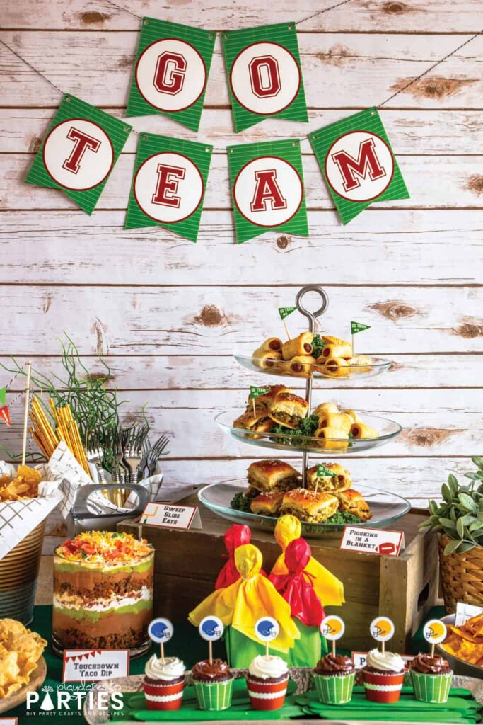 photo of a buffet table with game day food and a banner that says go team