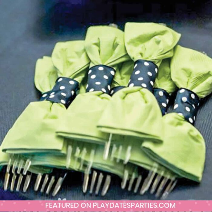 forks wrapped up for a party to look like green bowties