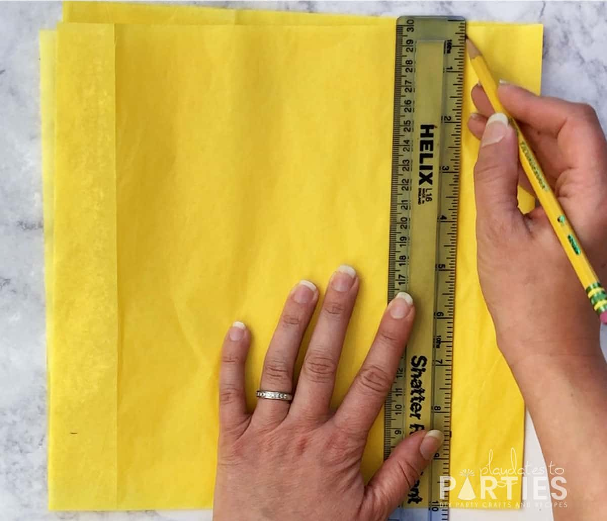 step 4 - measuring and marking 8 and one half inches across the top of the tissue paper