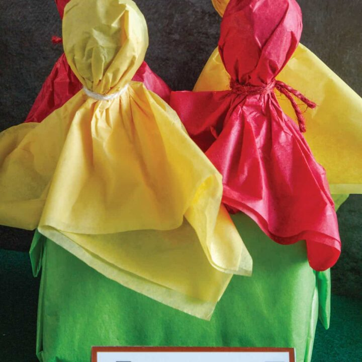 red and yellow covered lollipops that look like football penalty and challenge flags in a green stand with a tag in front that says penalty pops