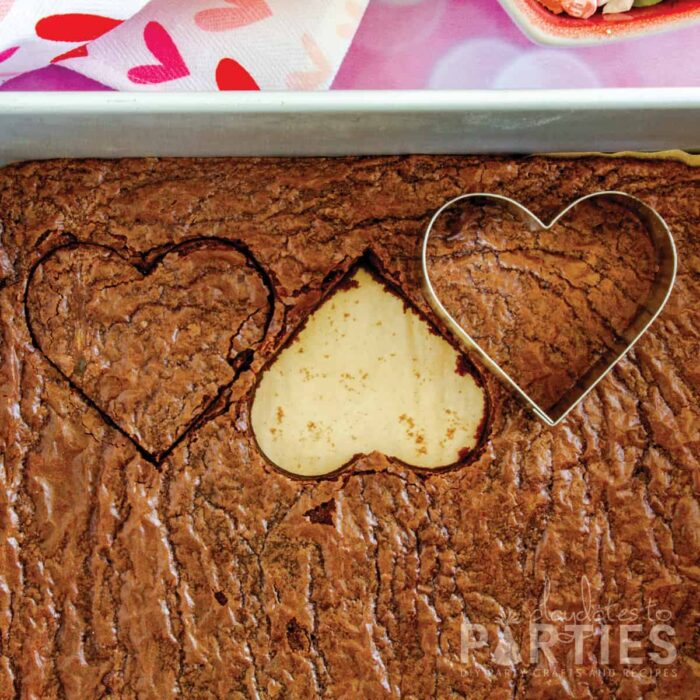 cutting brownies with a heart shaped cookie cutter