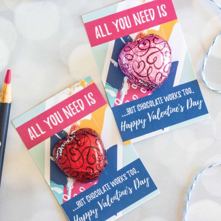 2 finished all you need is love valentines gifts with red and pink chocolate hearts on a gray surface
