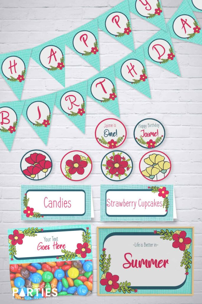 Blue and pink flower party printables banner, party circles, table tents, bag toppers, and sign in front of a white brick background