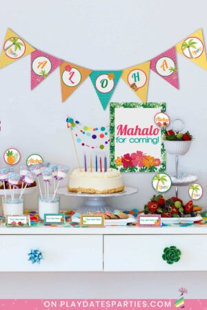 party dessert table a cake and sweet treats decorated with luau party printables