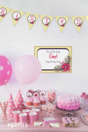 party dessert table with pink balloons and decorations with yellow and pink party printable banners, sign, cupcake toppers, and food labels