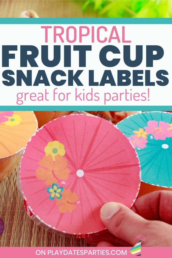 close up of a hand holding a fruit cup with a label that looks like a pink drink umbrella with the text tropical fruit cup snack labels great for kids parties