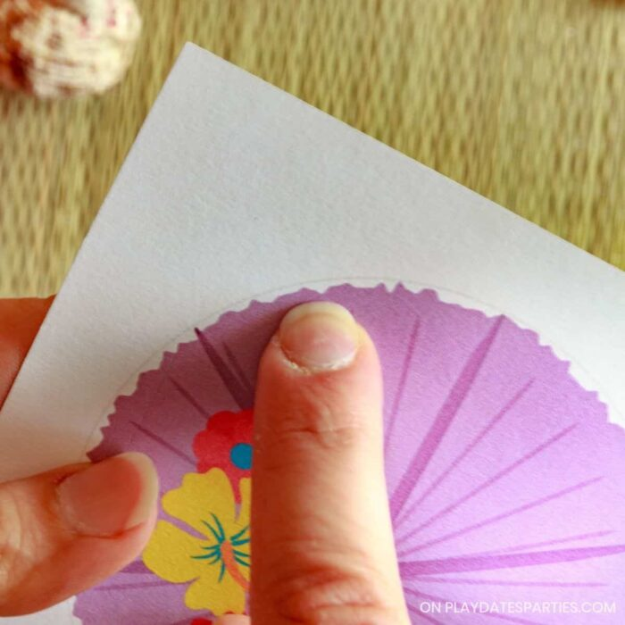 finger pointing out the cut line on a printable design