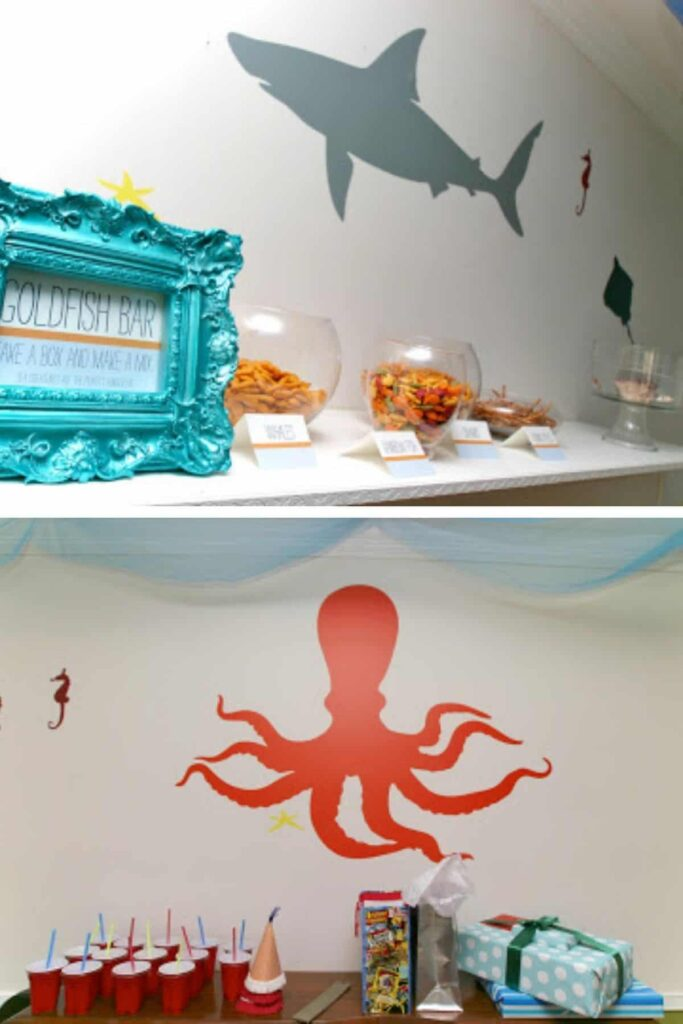 collage of shark, octopus, seahorse, and starfish decals on a wall for party decor