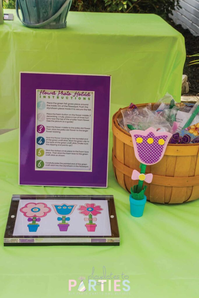 craft station with a sample of a flower craft and framed directions