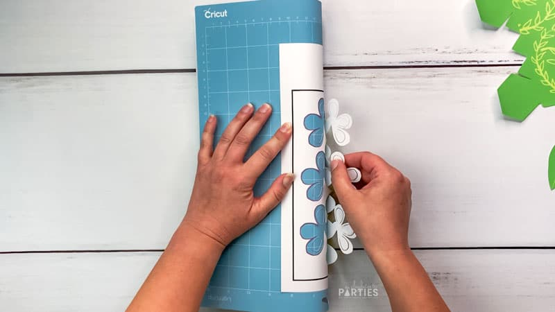 Unload the design from the Cricut mat starting with the most delicate areas.