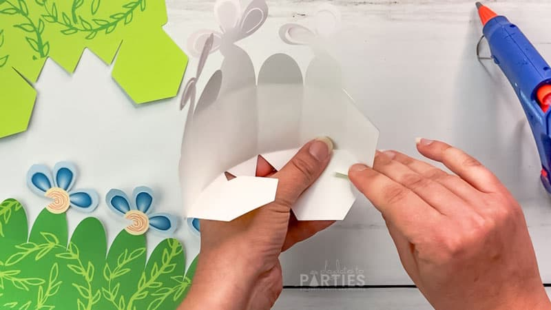 glue the triangle tabs to the top of the hexagon