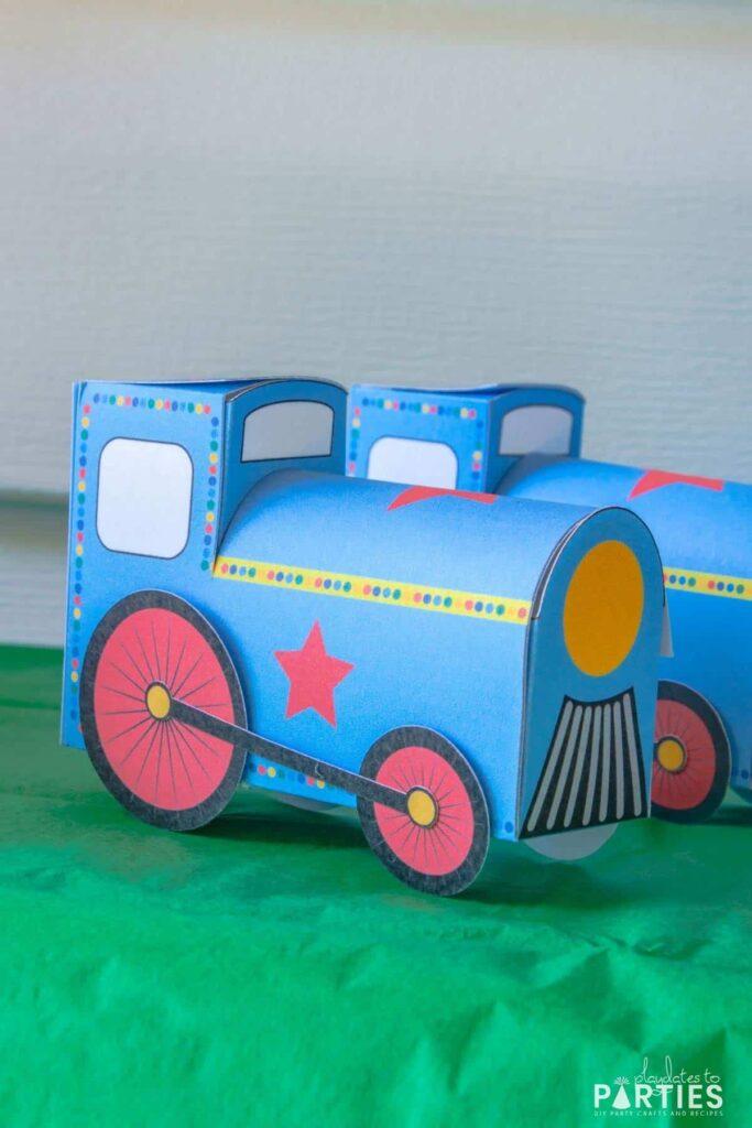 closeup of a three dimensional favor box that looks like a blue train