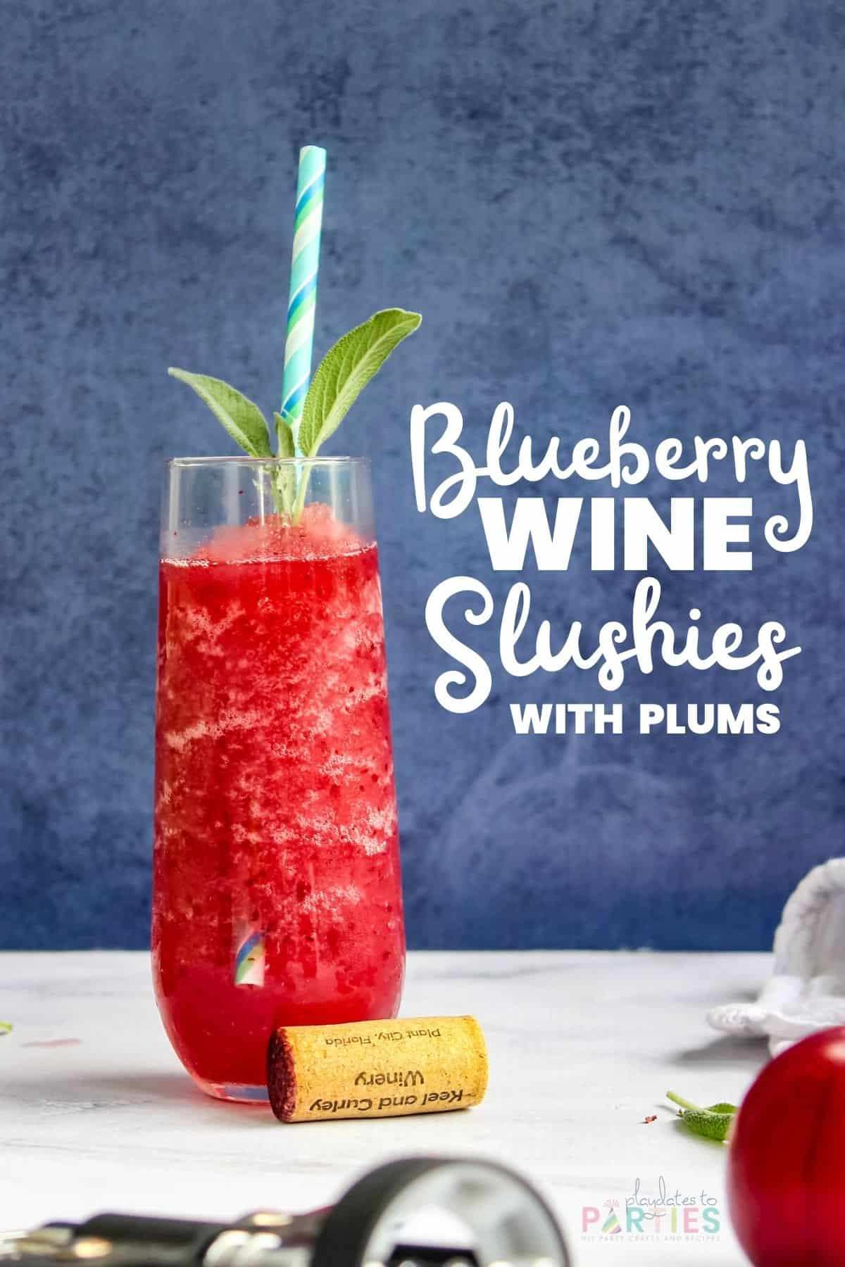 Colorful slushie in a stemless champagne flute on a marble surface with text overlay blueberry wine slushies with plums