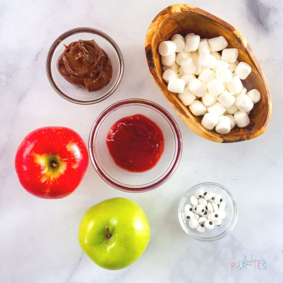 ingredients for making monster Halloween treats from apples