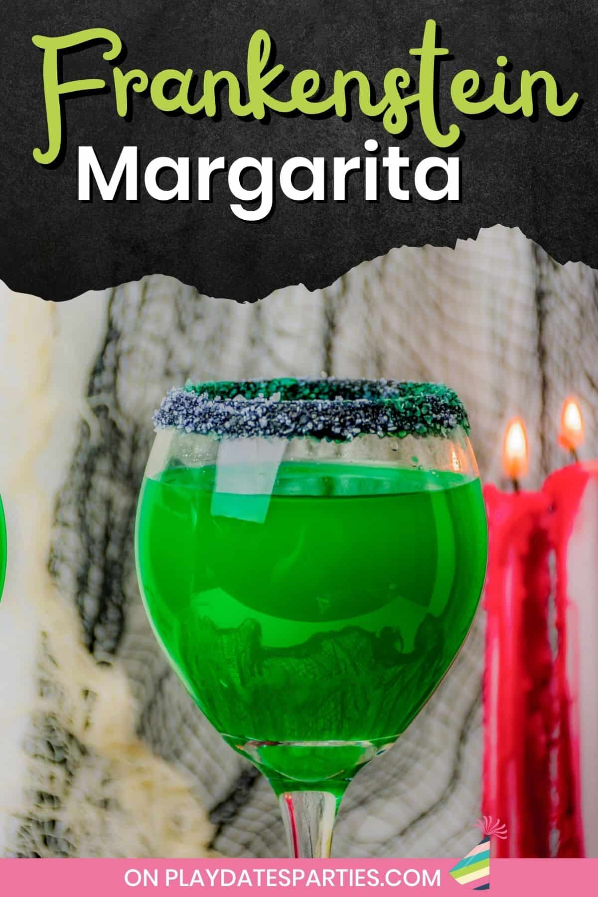 Close up of a wine glass rimmed with black and white margarita salt, and filled with a green cocktail.